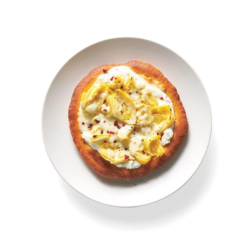 Photo de Créateur de recettes pizza artichauts, ricotta et huile de truffe prise par WW